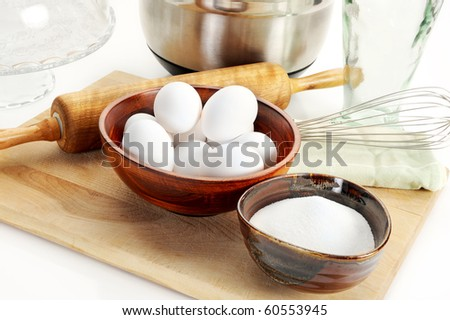 Baking ingredients, sugar, and eggs with other ingredients - stock photo