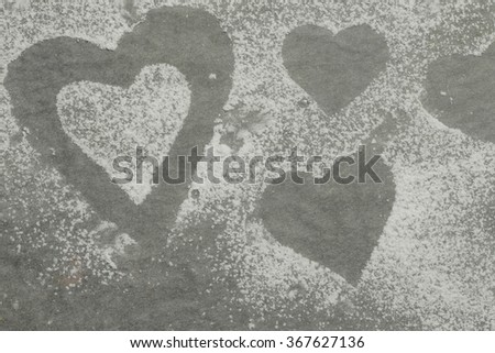 Baking paper covered with sugar powder - stock photo