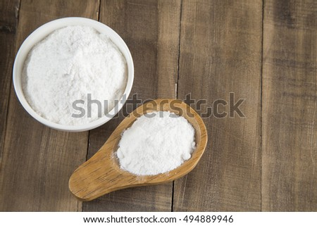 Baking soda into the bowl and wooden spoon