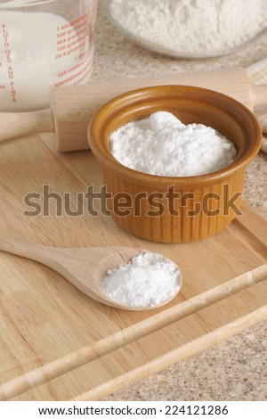 Baking Soda or Sodium bicarbonate used in baking as a leavening agent selective focus on the spoon - stock photo