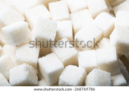 Baking. Sugar background sweet food ingredient with a close up of a pile of delicious white lumps of cubes as a symbol of cooking and baking and the diet health risks related to diabetes and calorie - stock photo