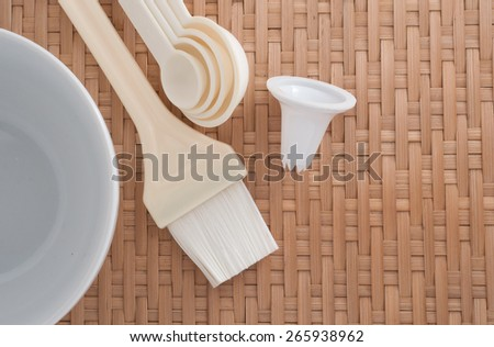 Baking tools on white table top on a bamboo background with side light