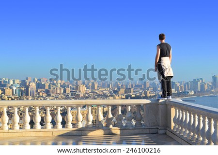 Baku, Azerbaijan - December 28, 2014:  Athlete on the parapet at the Highland Park - stock photo