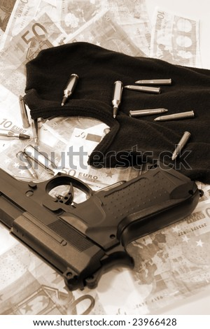 balaclava  money  a gun and bullets showing concept of a robber or terrorist activity - stock photo
