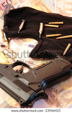 balaclava, money, gun and bullets showing concept of a robber or terrorist activity - stock photo