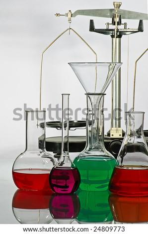 balance and laboratory glassware with liquid - stock photo