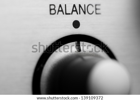 Balance knob on amplifier panel with brushed metal finish. - stock photo