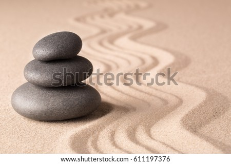 Balance of a pile or stack of stones in a Japanese zen meditation garden. Spa wellness hot stone therapy.