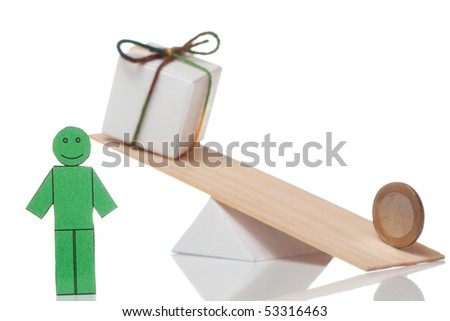 Balance of euro coin and present - stock photo