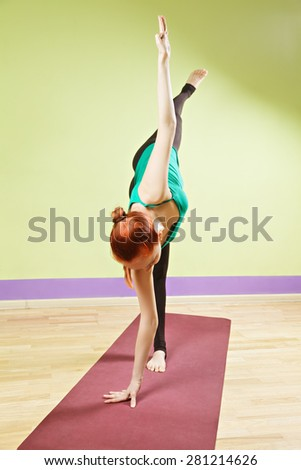 Balance on one hand and foot yoga position