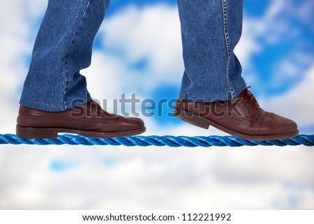 Balance on the tightrope - stock photo