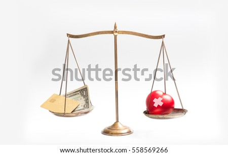 balance your health and make money for life time with scales on white background