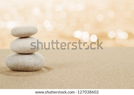 Balance zen stones in sand on white background - stock photo
