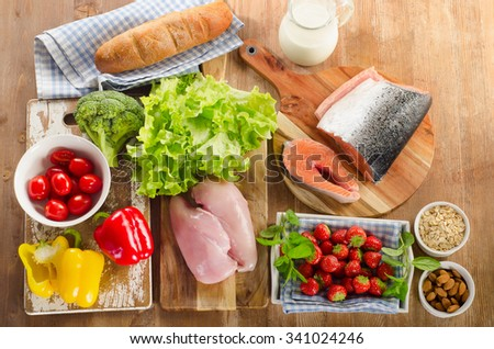 Balanced diet, healthy food concept  on wooden background. View from above - stock photo