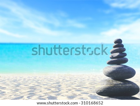 Balanced seven Zen stones on blurred beautiful the beach background. Concept of balance and harmony. World Mental Health Day, World Philosophy Day, Business, Education, Religion, Wisdom, Water concept - stock photo