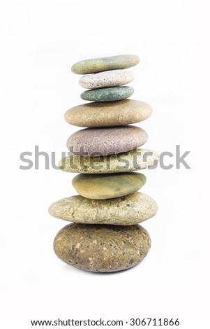 Balanced Zen stones isolated on white background - stock photo