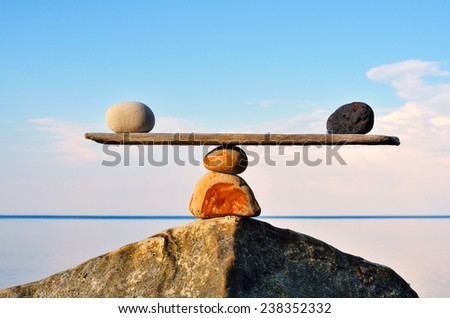 Balancing of pebbles on the top of stone - stock photo