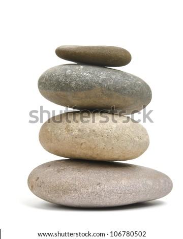Balancing stones isolated on white - stock photo