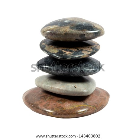 Balancing stones on a white background