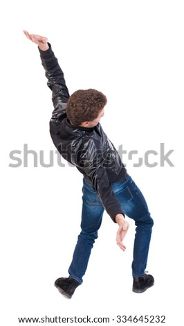Balancing young man or dodge falling man. Rear view people collection.  backside view of person.  Isolated over white background. The guy in the leather jacket falls on his back. - stock photo