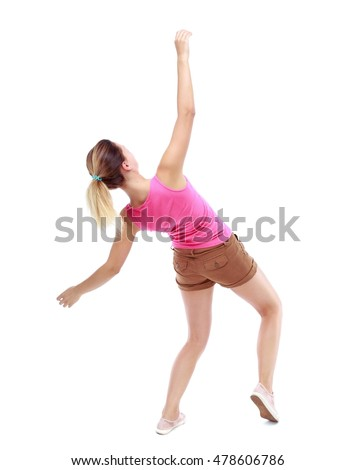 Balancing young woman. or dodge falling woman. Isolated over white background. Sport blond in brown shorts falls on his back.
