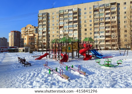 BALASHIKHA, RUSSIA - JANUARY, 21. A children's playground on the background of a multi-storey panel residential building on January 21, 2016. Balashikha, Moscow region, Russia. - stock photo