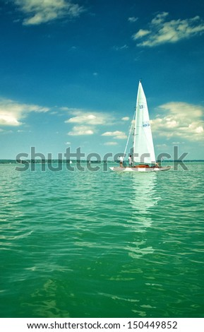 BALATON, HUNGARY - 27 AUGUST 2012: White sailboats on lake Balaton on 27 August, 2012. Lake Balaton, or The Balaton, is a freshwater lake in the Transdanubian region of Hungary.