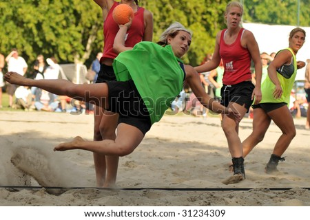 BALATONBOGLAR, HUNGARY - AUGUST 16 : An unidentified player ready to score at Hungarian national beach handball championship final (Marcali VSZSE vs OVB) August 16, 2008 in Balatonboglar.
