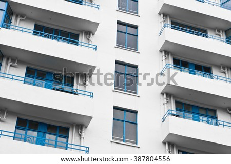 Balconies on a white apartment building in the UK - stock photo