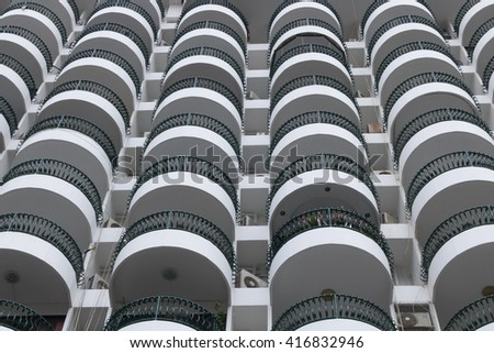 Balconies outside hotel building.Side view form street.