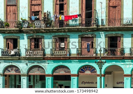 Balconies with laundry in the old part of the city on June 30, 2005 in Havana, Cuba. With its distinct and decayed atmosphere, Havana is the destination of more than 1 million visitors. - stock photo