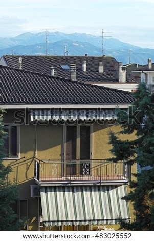 Balcony against the background of the Alps