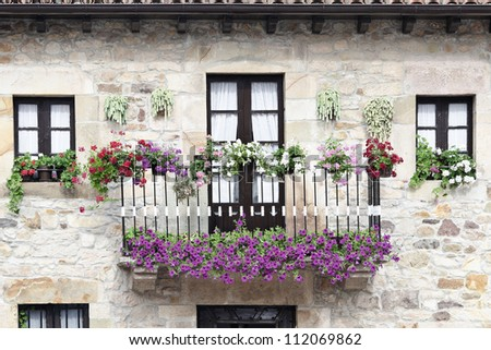 balcony decorated with flowers in the village of Lierganes, Cantabria, Spain