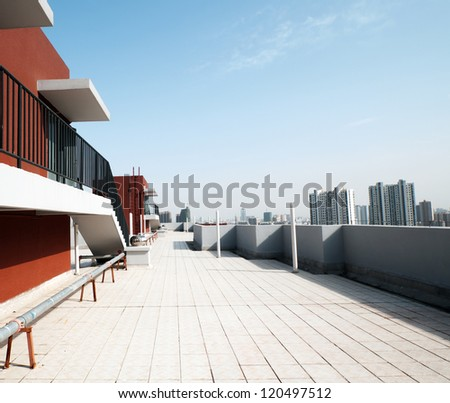 Balcony, floor, concrete fence and blue sky. Outdoor architecture, bottom perspective - stock photo