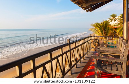 balcony in a villa in a hotel on the sea background on a sunny day - stock photo