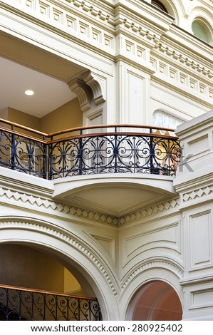 Balcony in classicism style of eighteenth century with curved arch and forged fence, architectural element  - stock photo