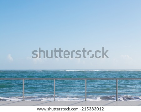 Balcony near sea under deep blue sky - stock photo