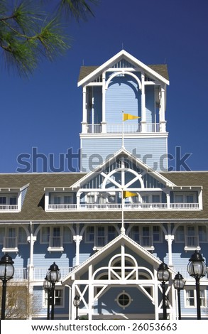 Balcony terrace and tower siding house with yellow flags - stock photo