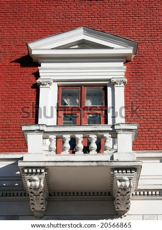 Balcony with red brick wall - stock photo