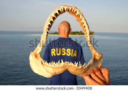 Bald headed diver  from Russia in the shark jaw - stock photo