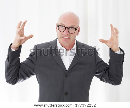 bald-headed man in a suit is upset - stock photo
