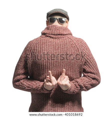 Bald man in a sweater, cap and sunglasses with his back showing the middle finger. Isolated - stock photo