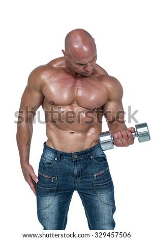 Bald man lifting dumbbells against white background - stock photo