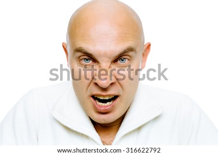 Bald man screams into the camera. Close-up. Isolated on white - stock photo