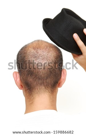 bald man with a hat