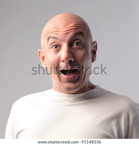 Bald man with astonished expression - stock photo
