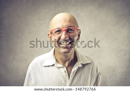bald man with glasses smiling - stock photo