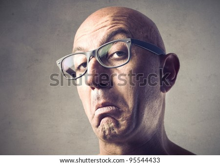 Bald man with snobbish expression - stock photo
