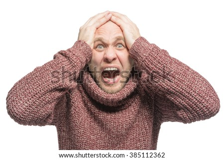 Bald unshaven man holding hands to head and shouts. Isolated