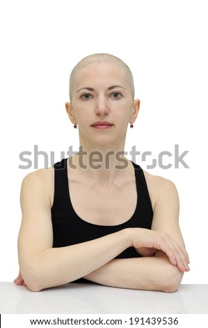Bald woman in black sleeveless shirt, isolated with clipping path.